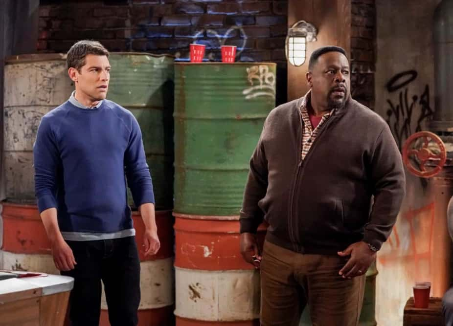 """The Neighborhood Season 3 Episode 14 """"Welcome to the Hero"""" – Pictured: Max Greenfield (Dave Johnson) and Cedric the Entertainer (Calvin Butler). Dave earns Calvin's respect when he thwarts a robbery at the barbershop, until the recognition goes to his head and he starts exaggerating the truth. Also, Marty invites an anxious Gemma to give his new stress-busting hobby a try, on THE NEIGHBORHOOD, Monday, April 19 (8:00-8:30 PM, ET/PT) on the CBS Television Network. Photo: Monty Brinton/CBS ©2021 CBS Broadcasting, Inc. All Rights Reserved."""
