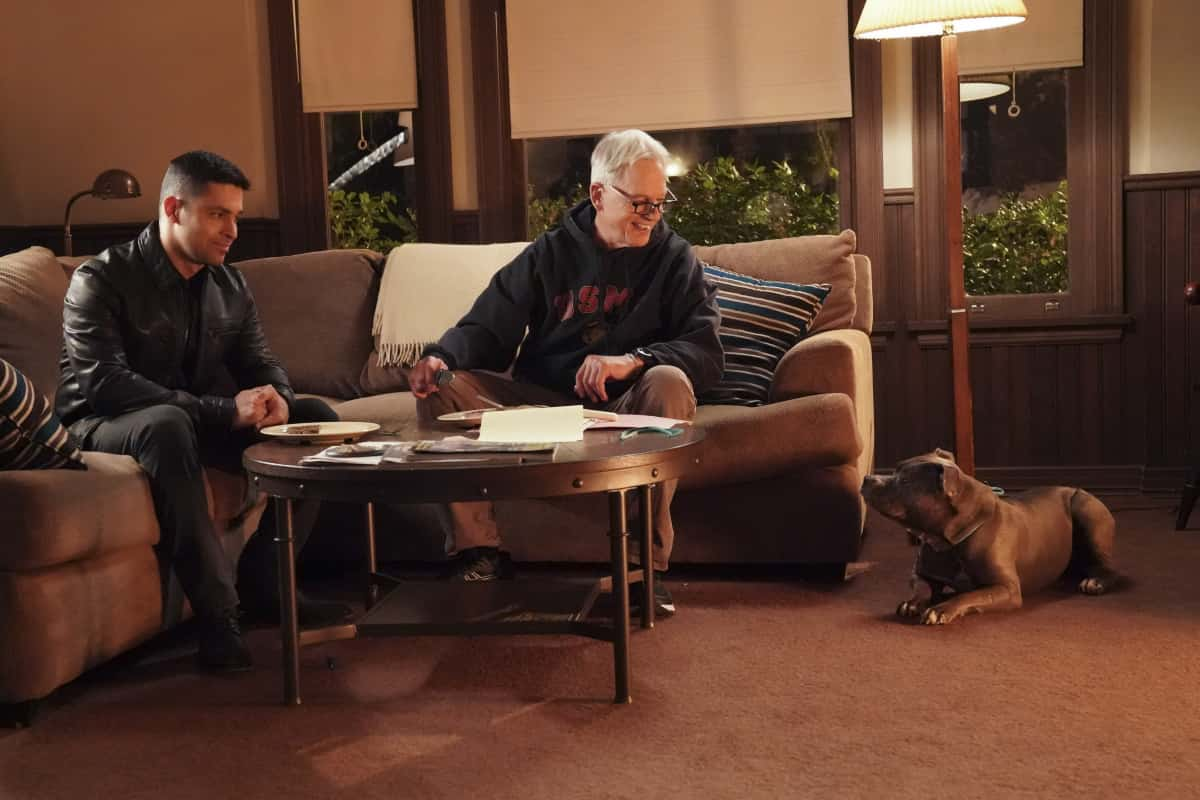 """NCIS Season 18 Episode 12 """"Sangre"""" – Evidence from the stabbing of a Marine Sergeant leads Torres to meet his father, Miguel (Steven Bauer), who left when he was a child, on NCIS, Tuesday, April 27 (8:00-9:00 PM, ET/PT) on the CBS Television Network. Pam Dawber returns as investigative reporter Marcie Warren. Pictured:   Wilmer Valderrama as NCIS Special Agent Nicholas """"Nick"""" Torres. Mark Harmon as NCIS Special Agent Leroy Jethro Gibbs. .  Photo: Bill Inoshita/CBS ©2021 CBS Broadcasting, Inc. All Rights Reserved."""
