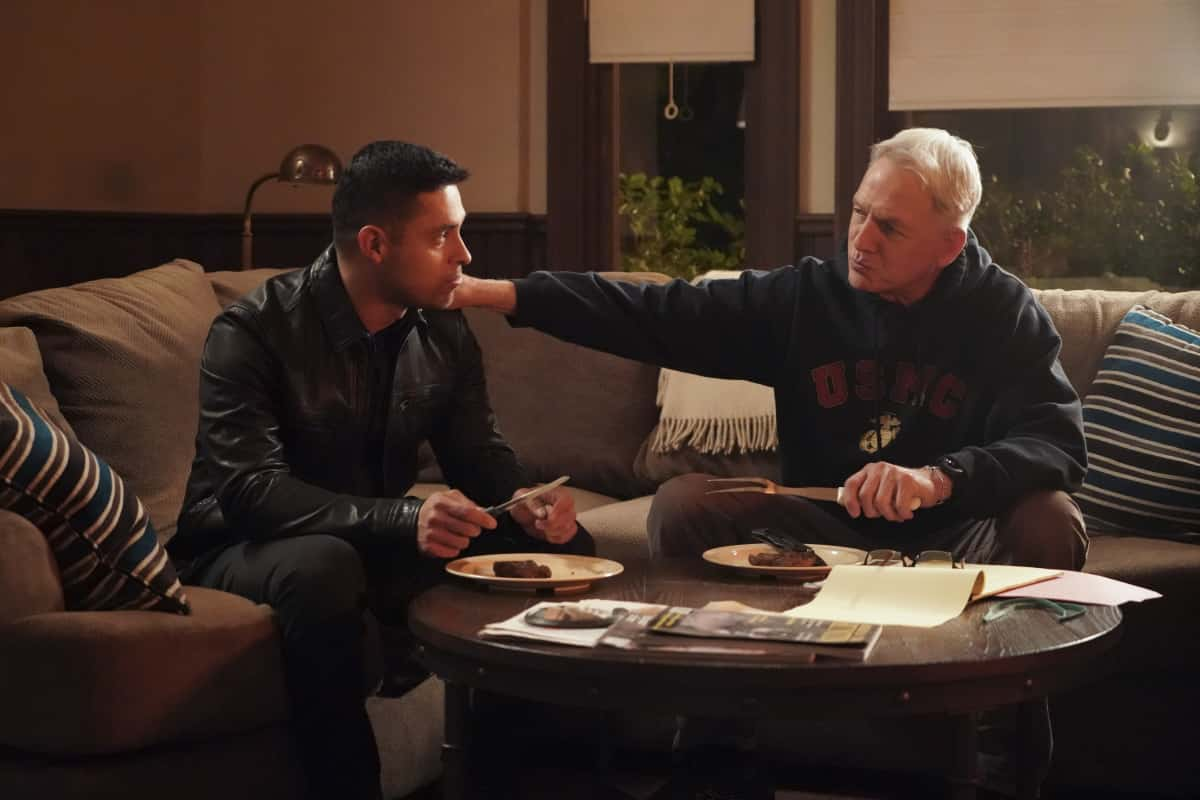 """NCIS Season 18 Episode 12 """"Sangre"""" – Evidence from the stabbing of a Marine Sergeant leads Torres to meet his father, Miguel (Steven Bauer), who left when he was a child, on NCIS, Tuesday, April 27 (8:00-9:00 PM, ET/PT) on the CBS Television Network. Pam Dawber returns as investigative reporter Marcie Warren. Pictured: Wilmer Valderrama as NCIS Special Agent Nicholas """"Nick"""" Torres, Mark Harmon as NCIS Special Agent Leroy Jethro Gibbs. .  Photo: Bill Inoshita/CBS ©2021 CBS Broadcasting, Inc. All Rights Reserved."""