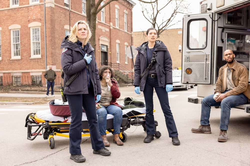 "CHICAGO FIRE Season 9 Episode 12 -- ""Natural Born Firefighter"" Episode 912 -- Pictured: (l-r) Kara Killmer as Sylvie Brett, Hanako Greensmith as Violet -- (Photo by: Adrian S. Burrows Sr./NBC)"