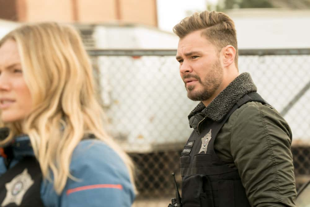 "CHICAGO PD Season 8 Episode 12-- ""Due Process"" Episode 812 -- Pictured: (l-r) Patrick John Flueger as Adam Ruzek -- (Photo by: Lori Allen/NBC)"
