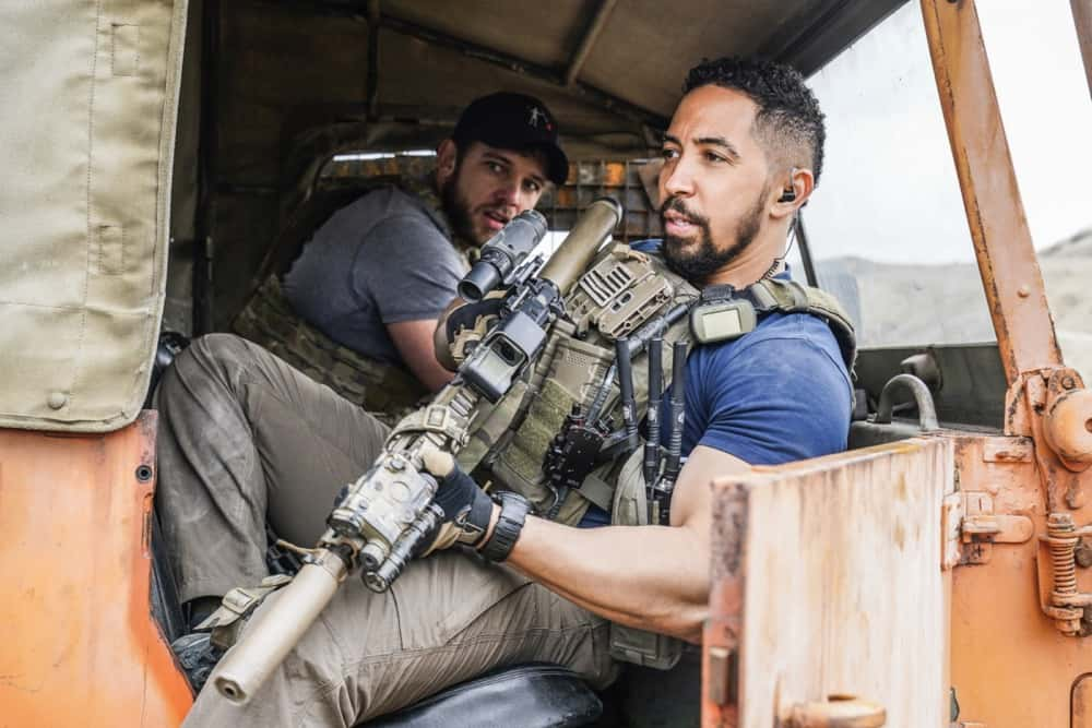 """Seal Team Season 4 Episode 12 """"Rearview Mirror"""" -- Jason\'s visit with a former teammate causes him to reevaluate his role as team leader. Also, several Bravo members grapple with their personal relationships when Command sends them on an unexpected mission to the coast of Africa, on SEAL TEAM, Wednesday, April 21 (9:00-10:00 PM, ET/PT) on the CBS Television Network. Pictured L to R: Max Thieriot as Clay Spenser and Neil Brown Jr. as Ray Perry. Photo: Monty Brinton/CBS ©2021 CBS Broadcasting, Inc. All Rights Reserved."""
