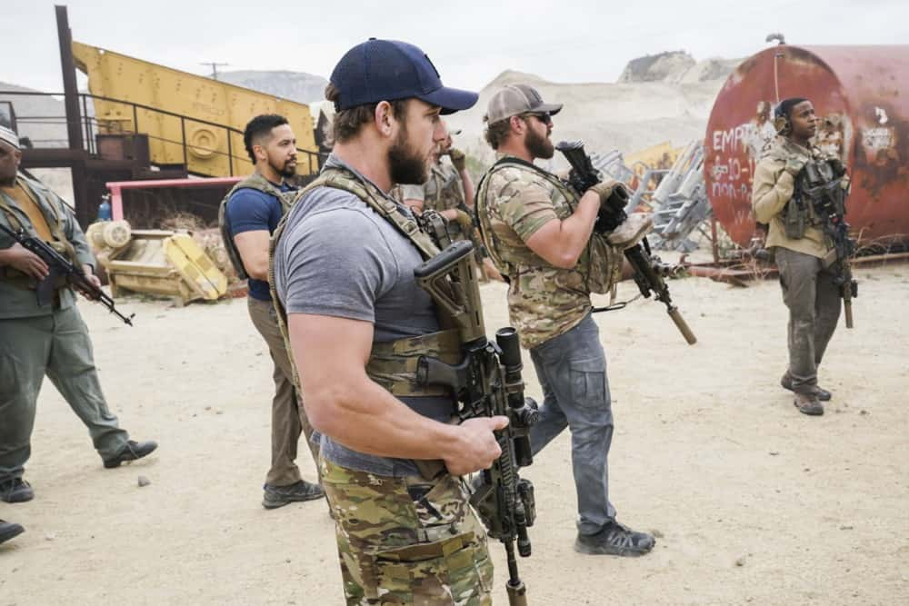 """Seal Team Season 4 Episode 12 """"Rearview Mirror"""" -- Jason\'s visit with a former teammate causes him to reevaluate his role as team leader. Also, several Bravo members grapple with their personal relationships when Command sends them on an unexpected mission to the coast of Africa, on SEAL TEAM, Wednesday, April 21 (9:00-10:00 PM, ET/PT) on the CBS Television Network. Pictured L to R: Neil Brown Jr. as Ray Perry, Max Thieriot as Clay Spenser, AJ Buckley as Sonny Quinn, and Mike Wade as Lt. Wes Soto. Photo: Monty Brinton/CBS ©2021 CBS Broadcasting, Inc. All Rights Reserved."""