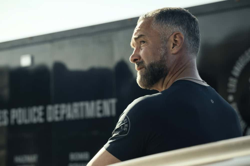 """SWAT Season 4 Episode 14 """"Reckoning"""" – As the team works to stop a violent attack on the city, they're forced to confront the group responsible for the death of team member, Erika Rogers. Also, Hondo and Leroy disagree on how to handle a challenge to Darryl's fledgling business, and Luca tries to recruit new TEMS officer Nora Fowler for an annual inter-squad competition, on S.W.A.T., Wednesday, April 21 (10:00-11:00 PM, ET/PT) on the CBS Television Network. Pictured (L-R): Jay Harrington as David """"Deacon"""" Kay.   Photo: Screengrab/CBS ©2021 CBS Broadcasting, Inc. All Rights Reserved"""