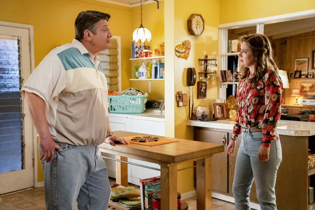 """Young Sheldon Season 4 Episode 15 """"A Virus, Heartbreak and a World of Possibilities"""" - Pictured: George Sr. (Lance Barber) and Mary (Zoe Perry). Sheldon is caught in a moral dilemma when offered a bootleg copy of a computer game he can't afford. Also, Mary and Meemaw take Brenda (Melissa Peterman) out for girls' night while George Sr. and the guys watch Billy, and Missy asks Georgie to take her and Marcus (London Cheshire) on a secret date, on YOUNG SHELDON, Thursday, April 22 (8:00-8:31 PM, ET/PT) on the CBS Television Network. Photo: Erik Voake/CBS ©2021 CBS Broadcasting, Inc. All Rights Reserved."""
