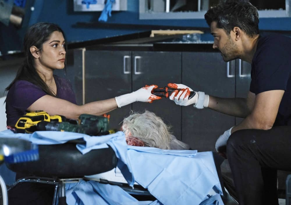 """THE RESIDENT Season 4 Episode 11 : L-R: Guest star Anuja Joshi and Manish Dayal in the """"After the Storm"""" episode of THE RESIDENT airing Tuesday, April 27 (8:00-9:01 PM ET/PT) on FOX. ©2021 Fox Media LLC Cr: Guy D'Alema/FOX"""