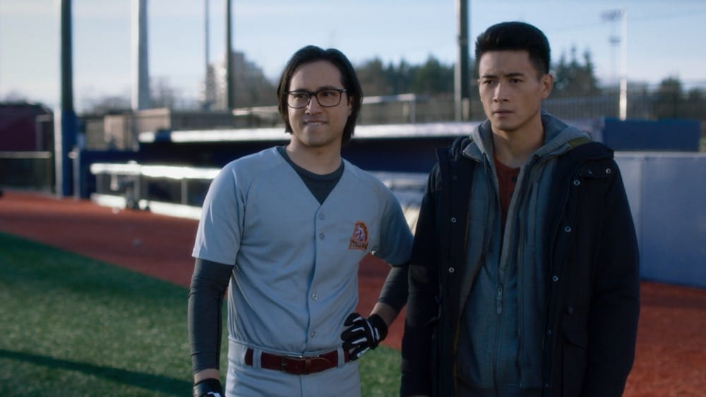"""Supergirl Season 6 Episode 5 -- """"Prom Night!"""" -- Image Number: SPG605fg_0015r.jpg -- Pictured: (L-R) Jesse Rath as Brainiac-5 and Peter Sudarso as Kenny Li Photo: The CW -- © 2021 The CW Network, LLC. All Rights Reserved."""
