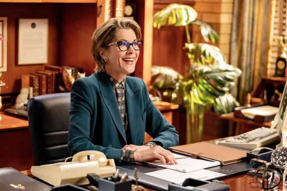 """Young Sheldon Season 4 Episode 16 """"A Second Prodigy and the Hottest Tips for Pouty Lips"""" - Pictured: President Hagemeyer (Wendie Malick). Sheldon finds himself at odds with Paige (Mckenna Grace) once again when she considers enrolling at East Texas Tech. Also, Mary seeks June's (Reba McEntire) advice when looking for a change, on YOUNG SHELDON, Thursday, April 29 (8:00-8:31 PM, ET/PT) on the CBS Television Network. Melissa Joan Hart returns to direct.  Photo Credit: Erik Voake/©2021 Warner Bros. Entertainment Inc. All Rights Reserved."""