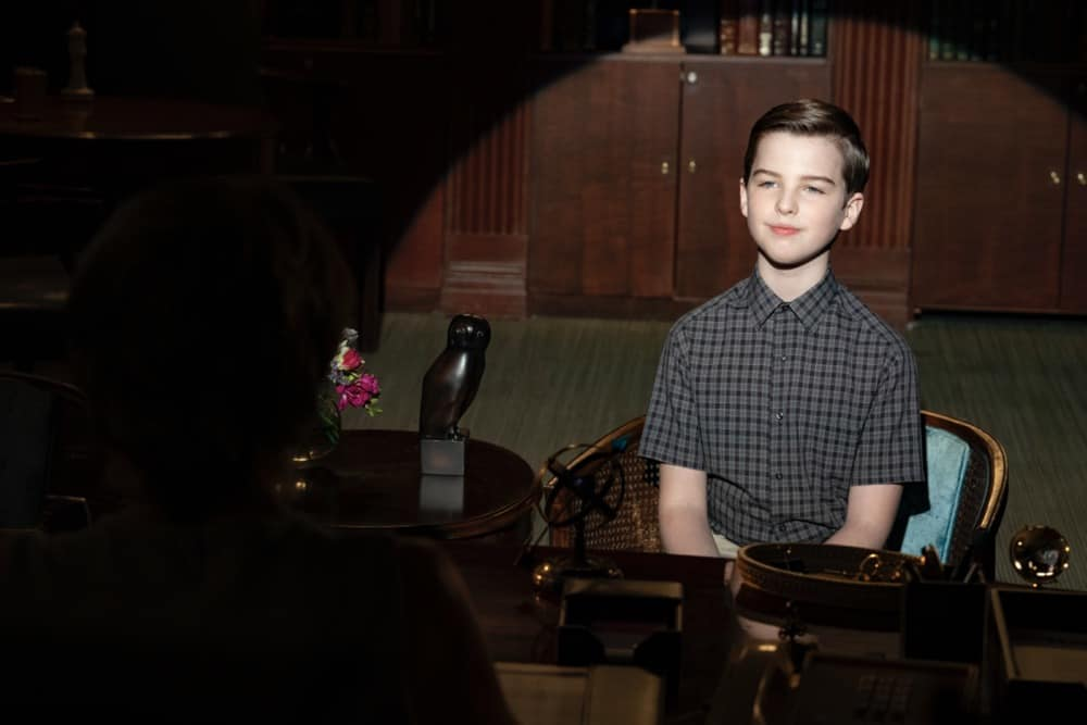 """Young Sheldon Season 4 Episode 16 """"A Second Prodigy and the Hottest Tips for Pouty Lips"""" - Pictured: Sheldon (Iain Armitage). Sheldon finds himself at odds with Paige (Mckenna Grace) once again when she considers enrolling at East Texas Tech. Also, Mary seeks June's (Reba McEntire) advice when looking for a change, on YOUNG SHELDON, Thursday, April 29 (8:00-8:31 PM, ET/PT) on the CBS Television Network. Melissa Joan Hart returns to direct.  Photo Credit: Erik Voake/©2021 Warner Bros. Entertainment Inc. All Rights Reserved."""