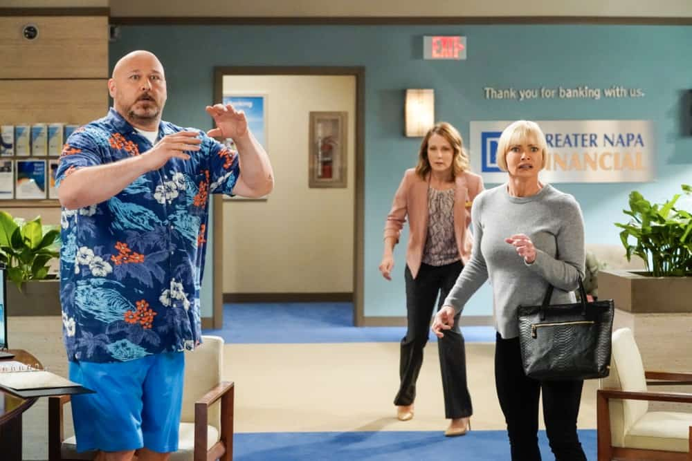 "Mom Season 8 Episode 16 ""Scooby-Doo Checks and Salisbury Steak"" – Bonnie decides to get to the bottom of why her therapist, Trevor (Rainn Wilson), has been so distracted. Also, Jill and Andy (Will Sasso) find themselves in a life or death situation, on MOM, Thursday, April 29 (9:01-9:30 PM, ET/PT) on the CBS Television Network. Pictured (L-R): Will Sasso as Andy and Jaime Pressly as Jill Photo: Robert Voets/ ©2021 Warner Bros. Entertainment Inc.  All Rights Reserved."