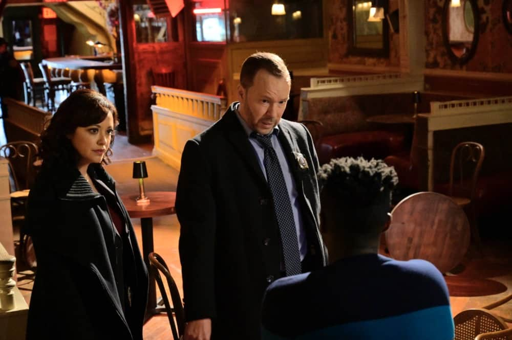 """Blue Bloods Season 11 Episode 13 """"Fallen Heroes"""" – Jamie faces official reprimand from Frank when he refuses to explain why he contests the arrest report of a fellow officer assaulted in the field, a rising rookie with allies in City Hall. Also, Danny and Baez clash when their lead suspect for the murder of a legendary comedy club owner is one of Danny's favorite standup comedians, and Eddie balks after she agrees to an undercover assignment for Anthony then learns his informant is Don Voorhees (James Le Gros), a former corrupt parole officer she and Jamie arrested, on BLUE BLOODS, Friday, April 30 (10:00-11:00 PM, ET/PT) on the CBS Television Network. Pictured: , Marisa Ramirez as Maria Baez, Donnie Wahlberg as Danny Reagan. Photo:   John Paul Filo/CBS ©2021 CBS BROADCASTING INC. ALL RIGHTS RESERVED."""