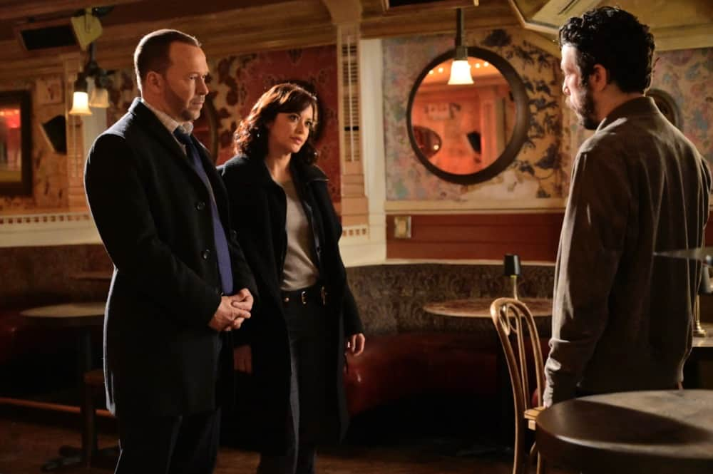 """Blue Bloods Season 11 Episode 13 """"Fallen Heroes"""" – Jamie faces official reprimand from Frank when he refuses to explain why he contests the arrest report of a fellow officer assaulted in the field, a rising rookie with allies in City Hall. Also, Danny and Baez clash when their lead suspect for the murder of a legendary comedy club owner is one of Danny's favorite standup comedians, and Eddie balks after she agrees to an undercover assignment for Anthony then learns his informant is Don Voorhees (James Le Gros), a former corrupt parole officer she and Jamie arrested, on BLUE BLOODS, Friday, April 30 (10:00-11:00 PM, ET/PT) on the CBS Television Network. Pictured: Donnie Wahlberg as Danny Reagan, Marisa Ramirez as Maria Baez.  Photo:   John Paul Filo/CBS ©2021 CBS BROADCASTING INC. ALL RIGHTS RESERVED."""