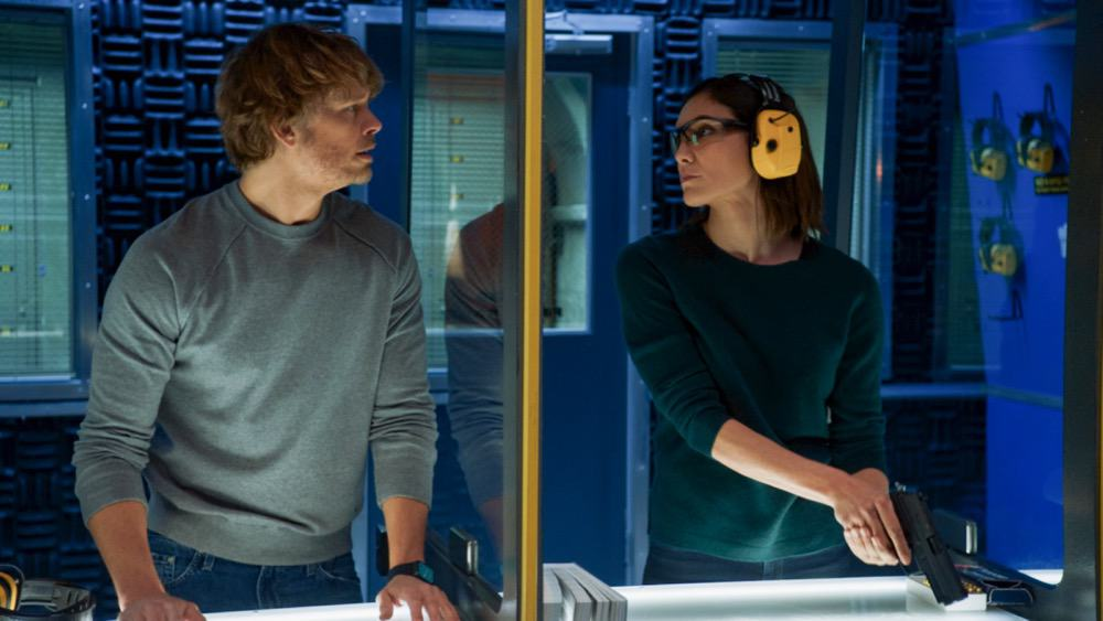 """NCIS Los Angeles Season 12 Episode 15 """"Imposter Syndrome"""" - Pictured: Eric Christian Olsen (LAPD Liaison Marty Deeks) and Daniela Ruah (Special Agent Kensi Blye). NCIS obtains a hard drive containing a realistic deep fake video of a deceased terrorist and must retrieve the dangerous technology behind it. However, when the team's comms are highjacked during their mission, they find that one of their own has been a victim of its potential, on NCIS: LOS ANGELES, Sunday, May 2 (9:00-10:00 PM, ET/PT) on the CBS Television Network. Photo: Screen Grab/CBS ©2021 CBS Broadcasting, Inc. All Rights Reserved."""