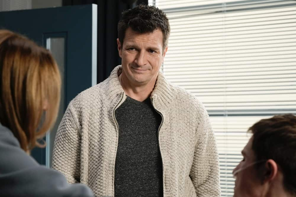 """THE ROOKIE Season 3 Episode 12 - """"Brave Heart"""" – After rushing his son, Henry, to the hospital following his collapse, Nolan is reunited with his ex-wife, Sarah, and they must come together to help their son. Meanwhile, Detective Lopez discovers """"La Fiera"""" is in the same hospital and wants to find out exactly why on """"The Rookie,"""" SUNDAY, MAY 2 (10:00-11:00 p.m. EDT), on ABC. (ABC/Scott Everett White) NATHAN FILLION"""