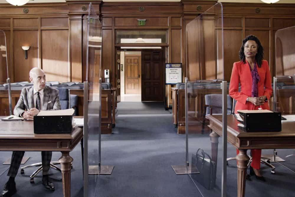 """All Rise Season 2 Episode 14 """"Caught Up in Circles"""" – Lola is conflicted when a former judge, Judge Prudence Jenkins, (Charlayne Woodard), whom she idolized, has been accused of bribery and is representing herself in a bench trial. Also, Mark moves forward with the case against McCarthy and he and Corrine Cuthbert (Anne Heche) each get one unchallenged request for a new judge, no questions asked, on ALL RISE, Monday, May 3 (9:00- 10:00 PM, ET/PT), on the CBS Television Network. Pictured (L-R): Mitch Silpa as DDA Clayton Berger and Charlayne Woodard as Judge Prudence Jenkins Photo: Screen Grab/CBS ©2021 CBS Broadcasting, Inc. All Rights Reserved."""