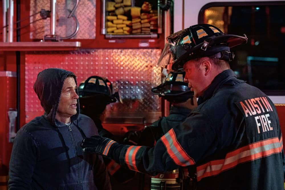 """9-1-1 LONE STAR Season 2 Episode 11: L-R: Rob Lowe and Jim Parrack in the """"Slow Burn"""" episode of 9-1-1: LONE STAR airing Monday, May 3 (9:01-10:00 PM ET/PT) on FOX. © 2021 Fox Media LLC. CR: Jack Zeman/FOX."""