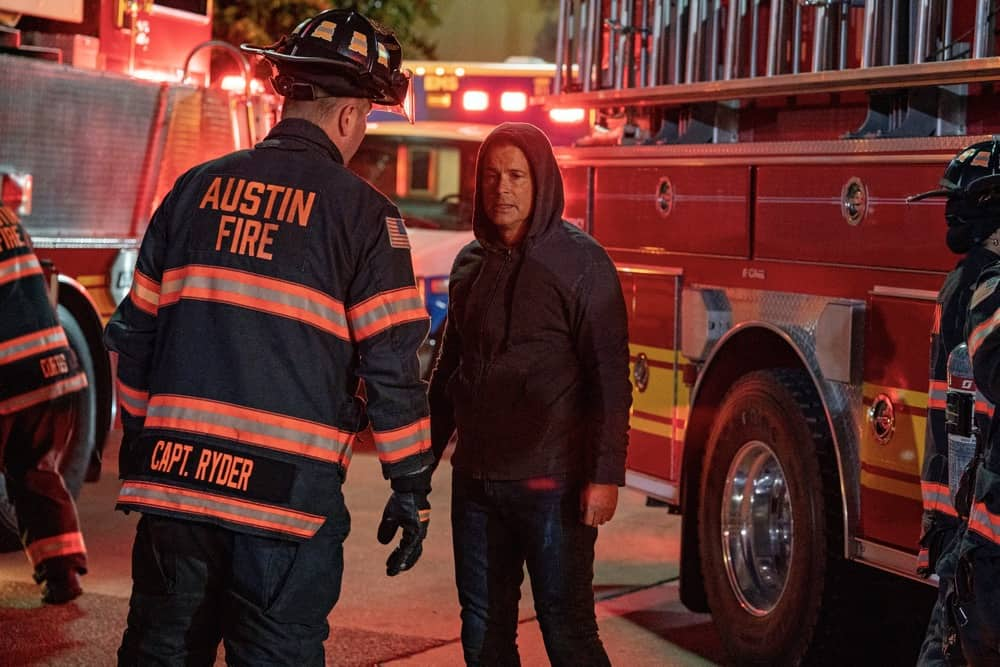 """9-1-1 LONE STAR Season 2 Episode 11 : L-R: Jim Parrack and Rob Lowe in the """"Slow Burn"""" episode of 9-1-1: LONE STAR airing Monday, May 3 (9:01-10:00 PM ET/PT) on FOX. © 2021 Fox Media LLC. CR: Jack Zeman/FOX."""