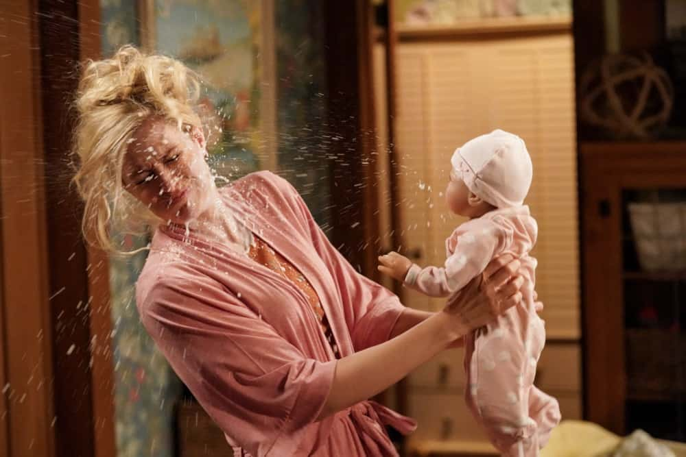 "THE NEIGHBORHOOD Season 3 Episode 16 ""Welcome to the Test Run"" - Pictured: Beth Behrs (Gemma Johnson). Baby vomiting on Gemma."