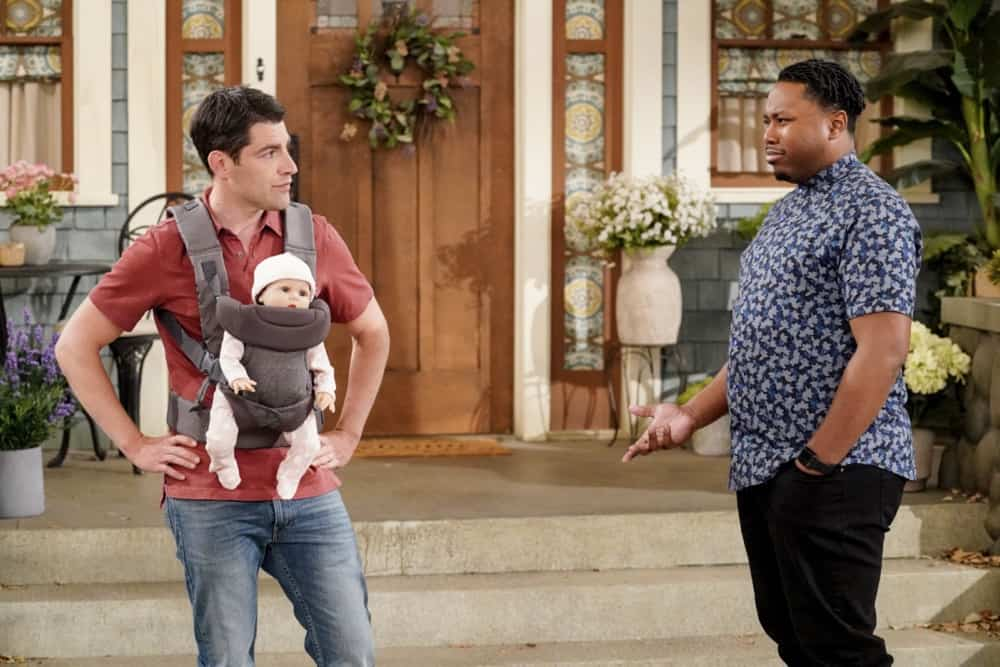 "THE NEIGHBORHOOD Season 3 Episode 16 ""Welcome to the Test Run"" - Pictured: Max Greenfield (Dave Johnson) and Marcel Spears (Marty Butler). When Gemma surprises Dave with wanting another baby, he worries she's forgotten how difficult a newborn is, so he enlists a robotic doll and Marty's engineering skills to remind her. Also, Calvin and Tina disagree on how to proceed when they unexpectedly discover a stash of cash, on THE NEIGHBORHOOD, Monday, May 3 (8:00-8:30 PM, ET/PT) on the CBS Television Network. Photo: Monty Brinton/CBS ©2021 CBS Broadcasting, Inc. All Rights Reserved."