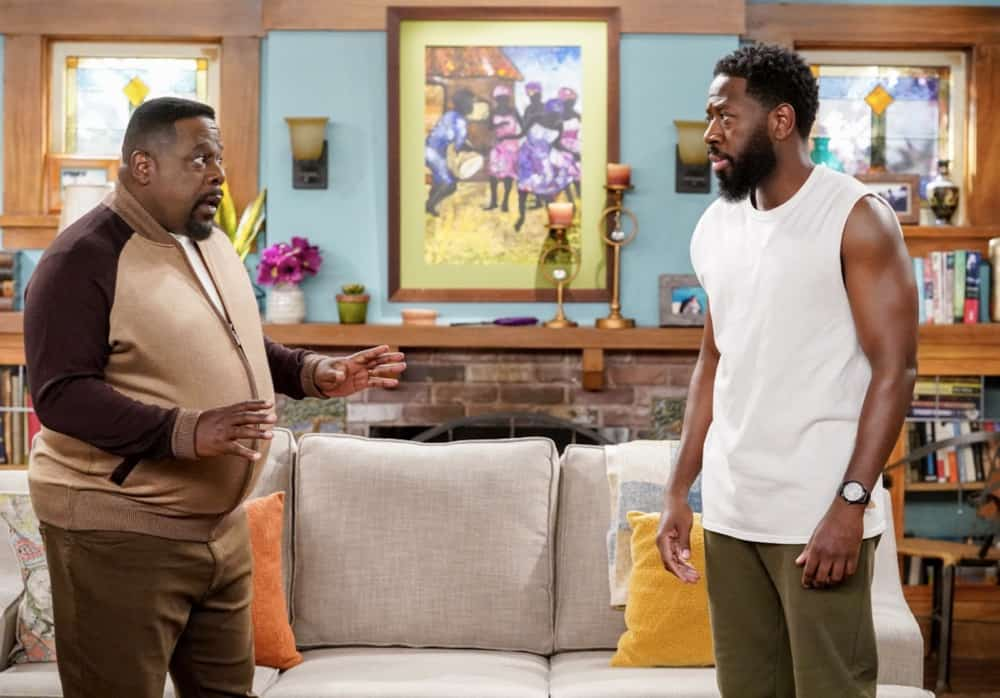 "THE NEIGHBORHOOD Season 3 Episode 16 ""Welcome to the Test Run"" - Pictured: Cedric the Entertainer (Calvin Butler) and Sheaun McKinney (Malcolm Butler). When Gemma surprises Dave with wanting another baby, he worries she's forgotten how difficult a newborn is, so he enlists a robotic doll and Marty's engineering skills to remind her. Also, Calvin and Tina disagree on how to proceed when they unexpectedly discover a stash of cash, on THE NEIGHBORHOOD, Monday, May 3 (8:00-8:30 PM, ET/PT) on the CBS Television Network. Photo: Monty Brinton/CBS ©2021 CBS Broadcasting, Inc. All Rights Reserved."