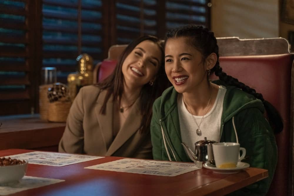 """NANCY DREW Season 2 Episode 14-- """"The Siege of the Unseen Specter"""" -- Image Number: NCD214a_0488r.jpg -- Pictured (L-R):  Maddison Jaizani as Bess and Leah Lewis as George -- Photo: Colin Bentley/The CW -- © 2021 The CW Network, LLC. All Rights Reserved."""