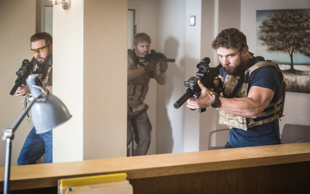 """SEAL TEAM Season 4 Episode 13 """"Do No Harm"""" -- Bravo is tasked with bringing a defecting Boko Haram lieutenant into U.S. custody, but the mission goes sideways when the target gets attacked. Also, Sonny drops the ball as Bravo\'s rep on the U.S.S. Keating, and the entire team pays the price, on SEAL TEAM, Wednesday, May 5 (9:00-10:00 PM, ET/PT) on the CBS Television Network. Episode directed by producer and recurring star Tyler Grey. Pictured L to R: AJ Buckley as Sonny Quinn Scott Foxx as Full Metal, Max Thieriot as Clay Spenser, Photo: Erik Voake/CBS ©2021 CBS Broadcasting, Inc. All Rights Reserved."""
