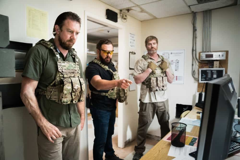 """SEAL TEAM Season 4 Episode 13 """"Do No Harm"""" -- Bravo is tasked with bringing a defecting Boko Haram lieutenant into U.S. custody, but the mission goes sideways when the target gets attacked. Also, Sonny drops the ball as Bravo\'s rep on the U.S.S. Keating, and the entire team pays the price, on SEAL TEAM, Wednesday, May 5 (9:00-10:00 PM, ET/PT) on the CBS Television Network. Episode directed by producer and recurring star Tyler Grey. Pictured L to R: Tyler Grey as Trent Sawyer, AJ Buckley as Sonny Quinn, and Scott Foxx as Full Metal. Photo: Erik Voake/CBS ©2021 CBS Broadcasting, Inc. All Rights Reserved."""
