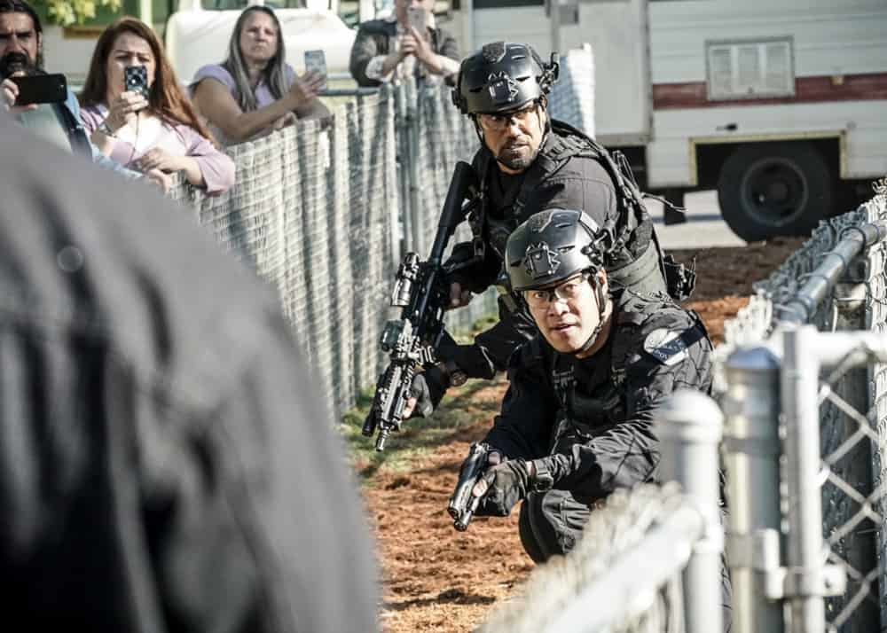 """SWAT Season 4 Episode 15 """"Local Heroes"""" – The team tries to track down a media-savvy crew of bank robbers who consider themselves a band of modern-day Robin Hoods, funneling stolen cash back into their struggling neighborhood, before the mission turns deadly. Also, Hondo and Deacon clash over how to deal with a group of cops' racist views, on S.W.A.T., Wednesday, May 5 (10:00-11:00 PM, ET/PT) on the CBS Television Network. Pictured (L-R): Shemar Moore as Daniel """"Hondo"""" Harrelson and David Lim as Victor Tan. Photo: Bill Inoshita/CBS ©2021 CBS Broadcasting, Inc. All Rights Reserved."""