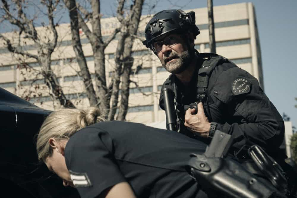 """SWAT Season 4 Episode 15 """"Local Heroes"""" – The team tries to track down a media-savvy crew of bank robbers who consider themselves a band of modern-day Robin Hoods, funneling stolen cash back into their struggling neighborhood, before the mission turns deadly. Also, Hondo and Deacon clash over how to deal with a group of cops' racist views, on S.W.A.T., Wednesday, May 5 (10:00-11:00 PM, ET/PT) on the CBS Television Network. Pictured (L-R): Jay Harrington as David """"Deacon"""" Kay.   Photo: Screengrab/CBS ©2020 CBS Broadcasting, Inc. All Rights Reserved"""