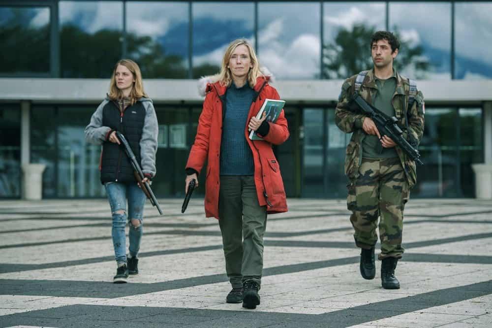 Pictured: (L-R) Emilie De Preissac as SOPHIA, Léa Drucker as CATHERINE, Paul Gorostidi as NATHAN in War of the Worlds, season 2.