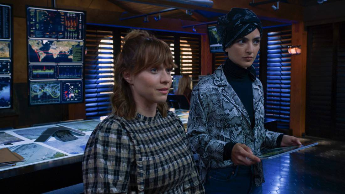 """NCIS LOS ANGELES Season 12 Episode 16 """"Signs of Change"""" - Pictured: Renée Felice Smith (Intelligence Analyst Nell Jones) and Medalion Rahimi (Special Agent Fatima Namazi). When military grade technology is stolen, a deaf engineer, Sienna Marchione (Raquel McPeek Rodriguez), who always wanted to serve her country, and the only member of her team to survive the theft, helps Kensi and NCIS track down the tech before it's taken out of the country, on NCIS: LOS ANGELES, Sunday, May 9 (9:00-10:00 PM, ET/PT) on the CBS Television Network.  Photo: Screen Grab/CBS ©2021 CBS Broadcasting, Inc. All Rights Reserved."""