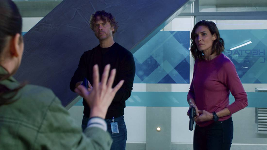 """NCIS LOS ANGELES Season 12 Episode 16 """"Signs of Change"""" - Pictured: Eric Christian Olsen (LAPD Liaison Marty Deeks) and Daniela Ruah (Special Agent Kensi Blye). When military grade technology is stolen, a deaf engineer, Sienna Marchione (Raquel McPeek Rodriguez), who always wanted to serve her country, and the only member of her team to survive the theft, helps Kensi and NCIS track down the tech before it's taken out of the country, on NCIS: LOS ANGELES, Sunday, May 9 (9:00-10:00 PM, ET/PT) on the CBS Television Network.  Photo: Screen Grab/CBS ©2021 CBS Broadcasting, Inc. All Rights Reserved."""