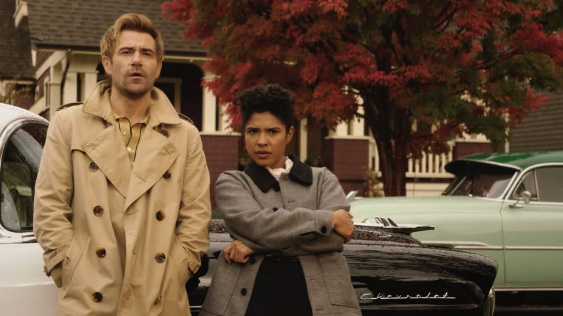 """LEGENDS OF TOMORROW Season 6 Episode 2 -- """"Meat: The Legends"""" -- Image Number: LGN602fg_0033r.jpg -- Pictured (L-R): Matt Ryan as Constantine and Lisseth Chavez as Esperanza """"Spooner"""" Cruz -- Photo: The CW -- © 2021 The CW Network, LLC. All Rights Reserved."""
