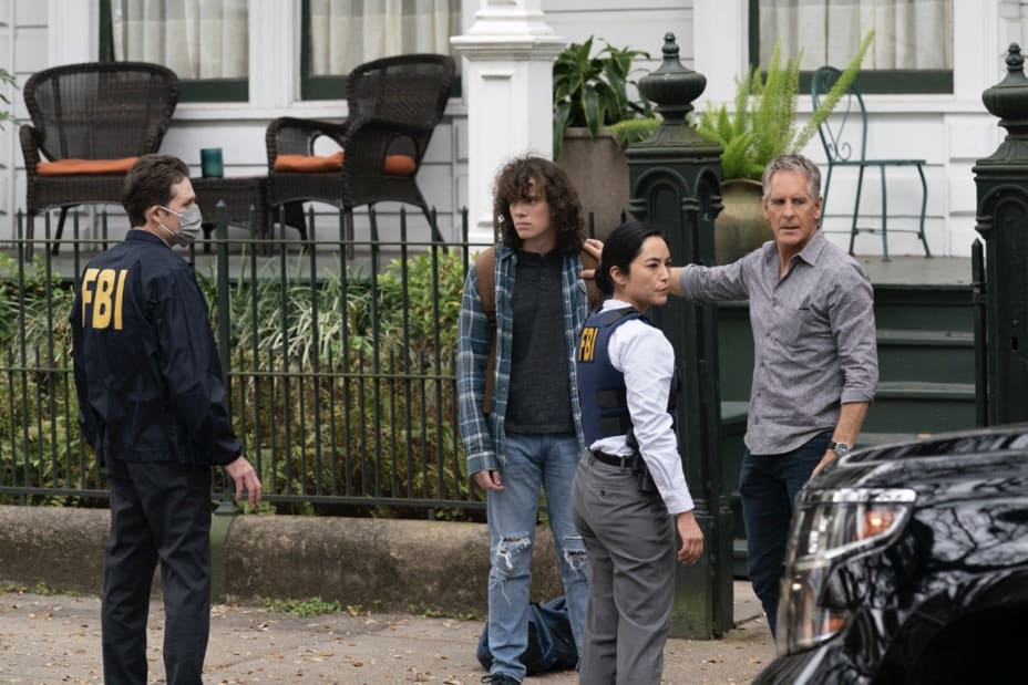 """NCIS NEW ORLEANS Season 7 Episode 14 """"Illusions"""" – As Pride directs the team to link Sasha to the recent attacks in New Orleans, he must help Connor come to terms with who his mother really is.  Also, Carter and Tammy must find a highly trained military dog who has been stolen and Pride and Rita make an important decision about their wedding, on """"NCIS: NEW ORLEANS,"""" Sunday, May 9 (10:00-11:00 PM, ET/PT) on the CBS Television Network. Pictured L-R: Drew Scheid as Connor Dean, Cara Mitsuko as Agent Lee, and Scott Bakula as Special Agent Dwayne Pride Photo: Sam Lothridge/CBS ©2021 CBS Broadcasting, Inc. All Rights Reserved."""