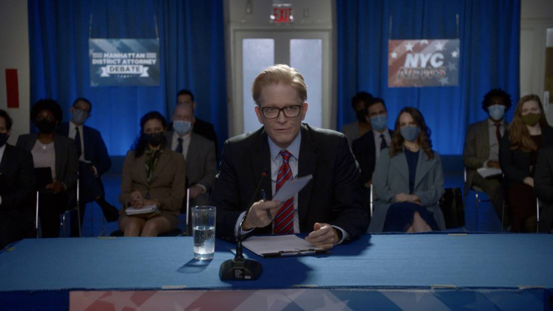 """BULL Season 5 Episode 15 """"Snatchback"""" – Eric Stoltz as the moderator Photo: Screen Grab/CBS ©2021 CBS Broadcasting, Inc. All Rights Reserved"""
