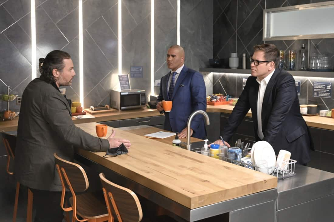 """BULL Season 5 Episode 15 """"Snatchback"""" – Bull aims to mount a federal trial defense without hard evidence when the federal government sues his client for fraud, a child recovery agent (Gino Anthony Pesi) whose covert work requires him to leave no proof behind of his operations. Also, Izzy wants Benny to consider hitting back at his opponent in the District Attorney race when the other candidate engages in mudslinging to sully Benny's public image before an important debate, on BULL, Monday, May 10 (10:00-11:00 PM, ET/PT) on the CBS Television Network.  Pictured L-R: Gino Anthony Pesi as Hank Alston, Christopher Jackson as Chunk Palmer, and Michael Weatherly as Dr. Jason Bull Photo: David M. Russell/CBS ©2021 CBS Broadcasting, Inc. All Rights Reserved"""