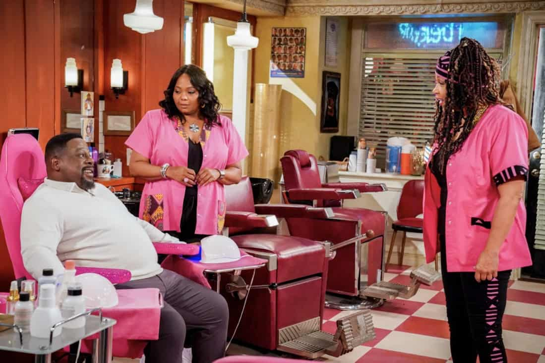"""THE NEIGHBORHOOD Season 3 Episode 17 """"Welcome to the Invasion"""" – Pictured: Cedric the Entertainer (Calvin Butler), Cocoa Brown (Regina), and Kym Whitley (LaTonya). When Calvin's arch-rivals, the Pink Ladies, move their manicure business into the local barbershop, Dave encourages him to make peace until the women take a prank too far and the guys decide to plot revenge. Also, Gemma helps Tina find a creative way to keep tabs on Marty and Malcolm's dating lives, on THE NEIGHBORHOOD, Monday, May 10 (8:00-8:30 PM, ET/PT) on the CBS Television Network. Kym Whitley and Cocoa Brown return as the Pink Ladies. Photo: Monty Brinton/CBS ©2021 CBS Broadcasting, Inc. All Rights Reserved."""