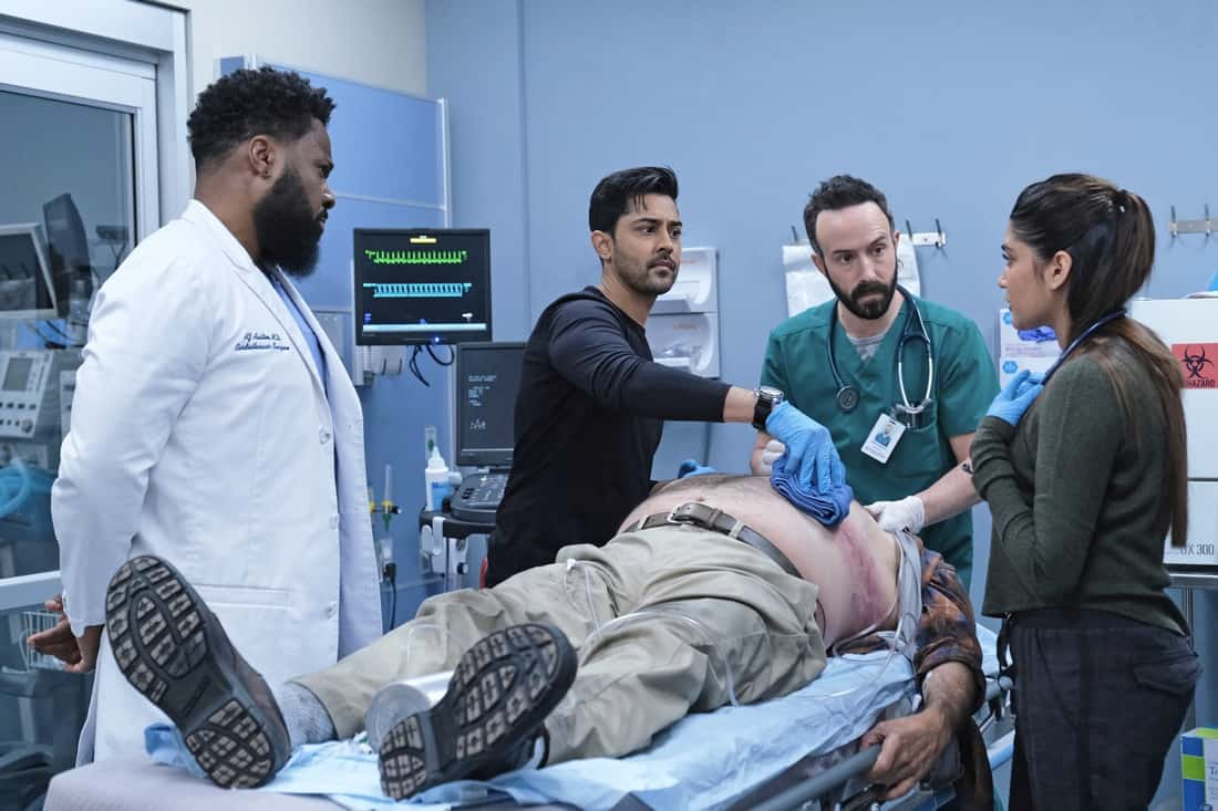 THE RESIDENT Season 4 Episode 13 : L-R: Malcolm-Jamal Warner, Manish Dayal, guest star Tasso Feldman and guest star Anuja Joshi in the ìA Childrenís Storyî episode of THE RESIDENT airing Tuesday, May 11 (8:00-9:01 PM ET/PT) on FOX. ©2021 Fox Media LLC Cr: Guy D'Alema/FOX