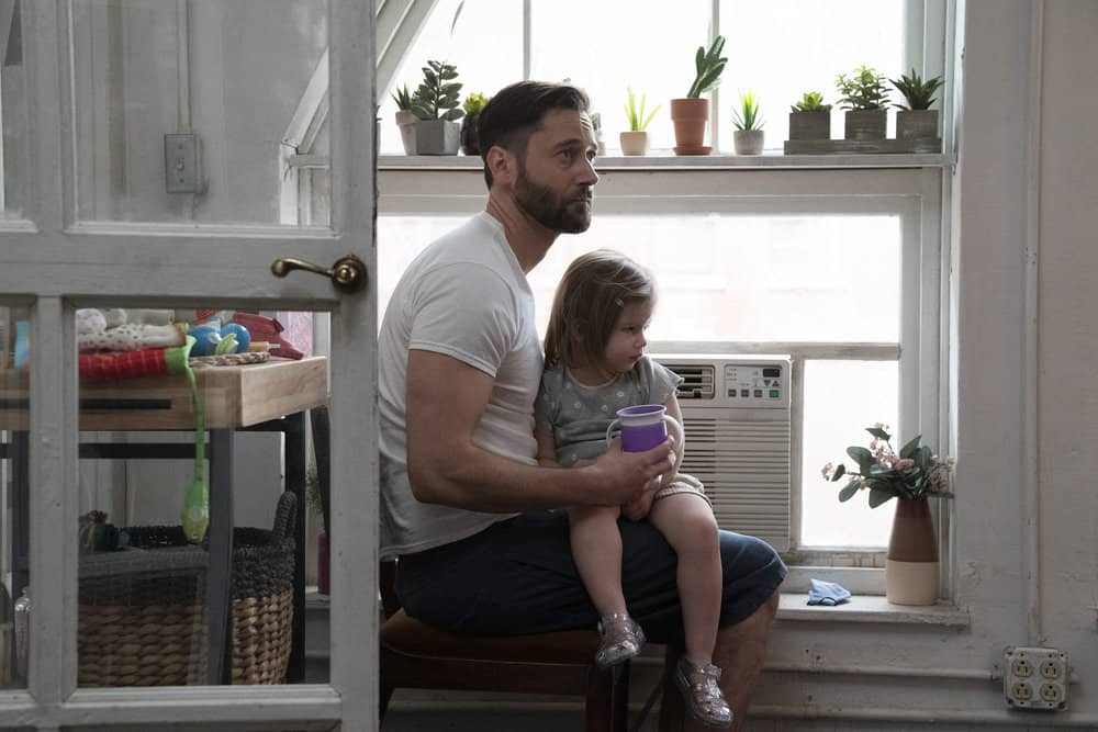 """NEW AMSTERDAM Season 3 Episode 11 -- """"Pressure Drop"""" Episode 311 -- Pictured: (l-r) Ryan Eggold as Dr. Max Goodwin, Nora and Opal Clow as Luna Goodwin -- (Photo by: Virginia Sherwood/NBC)"""