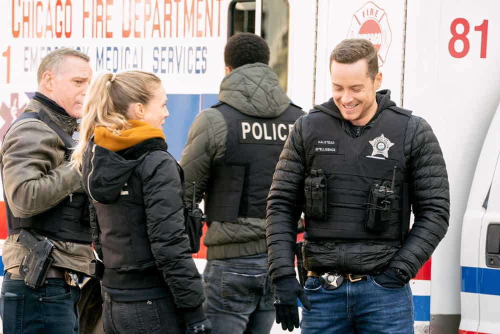 "CHICAGO PD Season 8 Episode 14 -- ""Safe"" Episode 814 -- Pictured: (l-r) Jason Beghe as Hank Voight, Tracy Spiridakos as Hailey Upton, Jesse Lee Soffer as Jay Halstead -- (Photo by: Lori Allen/NBC)"