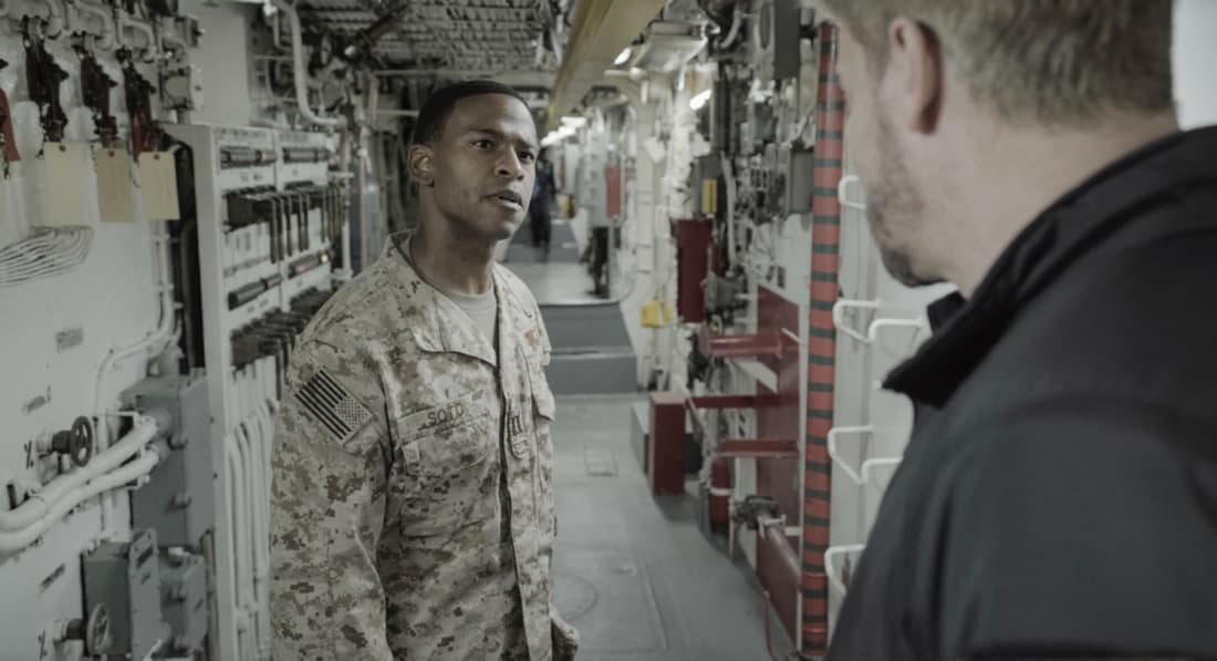"""SEAL TEAM Season 4 Episode 14 """"Hollow at the Core"""" – Bravo is tasked with a covert mission to infiltrate a Boko Haram camp, hack its data network and rescue an American hostage, on SEAL TEAM, Wednesday, May 12 (9:00-10:00 PM, ET/PT) on the CBS Television Network. Pictured: Mike Wade as Lt. Wes Soto. Photo: CBS ©2021 CBS Broadcasting, Inc. All Rights Reserved."""