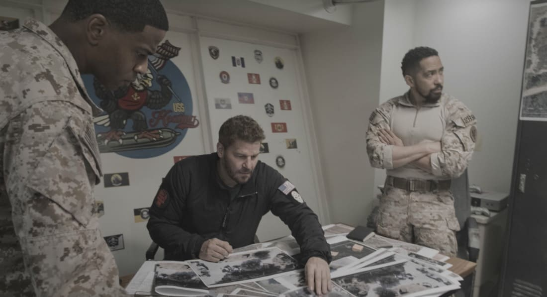 """SEAL TEAM Season 4 Episode 14 """"Hollow at the Core"""" – Bravo is tasked with a covert mission to infiltrate a Boko Haram camp, hack its data network and rescue an American hostage, on SEAL TEAM, Wednesday, May 12 (9:00-10:00 PM, ET/PT) on the CBS Television Network. Pictured L to R: Mike Wade as Lt. Wes Soto, David Boreanaz as Jason Hayes, and Neil Brown Jr. as Ray Perry. Photo: CBS ©2021 CBS Broadcasting, Inc. All Rights Reserved."""