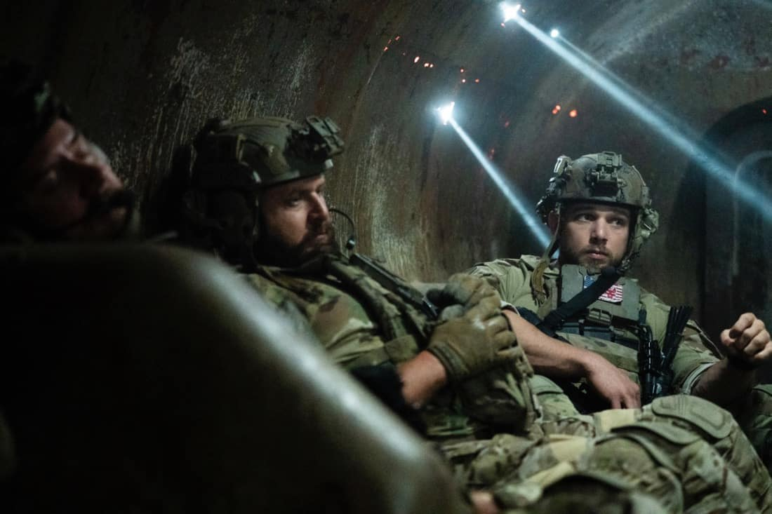 """SEAL TEAM Season 4 Episode 14 """"Hollow at the Core"""" – Bravo is tasked with a covert mission to infiltrate a Boko Haram camp, hack its data network and rescue an American hostage, on SEAL TEAM, Wednesday, May 12 (9:00-10:00 PM, ET/PT) on the CBS Television Network. Pictured L to R: AJ Buckley as Sonny Quinn and Max Thieriot as Clay Spenser. Photo: Sonja Flemming/CBS ©2021 CBS Broadcasting, Inc. All Rights Reserved."""