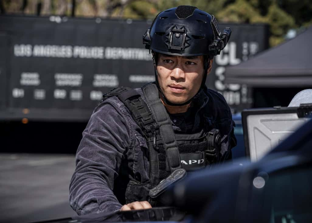 """SWAT Season 4 Episode 16 """"Lockdown"""" – When four escaped prisoners take control of a courthouse with Hondo and Deacon inside but unarmed, the two race to save the lives of innocent civilians while trying to avoid detection themselves. Also, Street visits his mother, Karen (Sherilynn Fenn), in the hospital and faces a pivotal decision, on S.W.A.T., Wednesday, May 12 (10:00-11:00 PM, ET/PT), on the CBS Television Network. Pictured (L-R): David Lim as Victor Tan. Photo: Sonja Flemming/CBS ©2021 CBS Broadcasting, Inc. All Rights Reserved."""