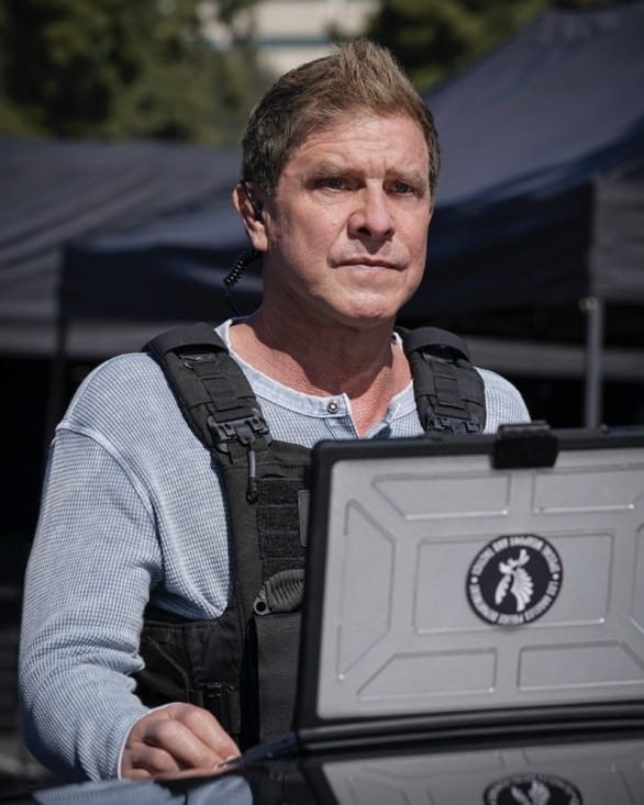 """SWAT Season 4 Episode 16 """"Lockdown"""" – When four escaped prisoners take control of a courthouse with Hondo and Deacon inside but unarmed, the two race to save the lives of innocent civilians while trying to avoid detection themselves. Also, Street visits his mother, Karen (Sherilynn Fenn), in the hospital and faces a pivotal decision, on S.W.A.T., Wednesday, May 12 (10:00-11:00 PM, ET/PT), on the CBS Television Network. Pictured (L-R): Kenneth """"Kenny"""" Johnson as Dominique Luca. Photo: Sonja Flemming/CBS ©2021 CBS Broadcasting, Inc. All Rights Reserved."""