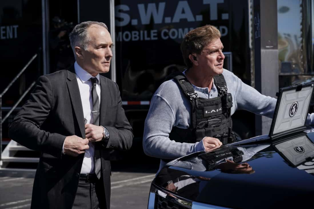 """SWAT Season 4 Episode 16 """"Lockdown"""" – When four escaped prisoners take control of a courthouse with Hondo and Deacon inside but unarmed, the two race to save the lives of innocent civilians while trying to avoid detection themselves. Also, Street visits his mother, Karen (Sherilynn Fenn), in the hospital and faces a pivotal decision, on S.W.A.T., Wednesday, May 12 (10:00-11:00 PM, ET/PT), on the CBS Television Network. Pictured (L-R): Patrick St. Esprit as Commander Robert Hicks and Kenneth """"Kenny"""" Johnson as Dominique Luca. Photo: Sonja Flemming/CBS ©2021 CBS Broadcasting, Inc. All Rights Reserved."""