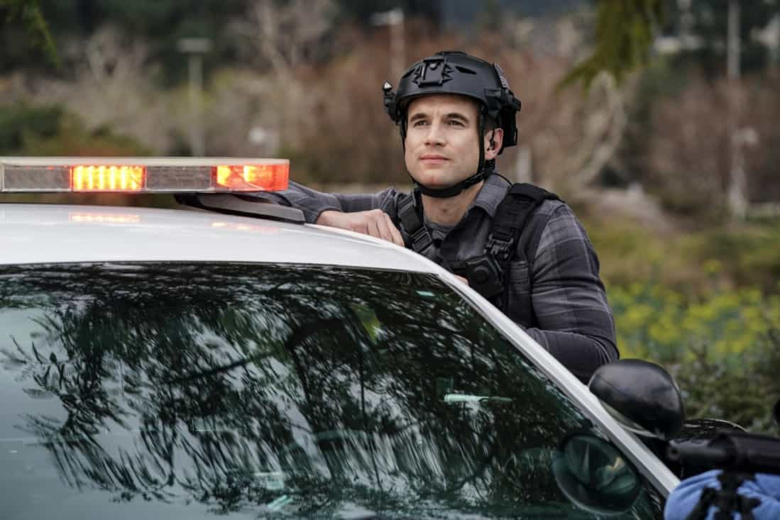 """SWAT Season 4 Episode 16 """"Lockdown"""" – When four escaped prisoners take control of a courthouse with Hondo and Deacon inside but unarmed, the two race to save the lives of innocent civilians while trying to avoid detection themselves. Also, Street visits his mother, Karen (Sherilynn Fenn), in the hospital and faces a pivotal decision, on S.W.A.T., Wednesday, May 12 (10:00-11:00 PM, ET/PT), on the CBS Television Network. Pictured (L-R): Alex Russell as Jim Street. Photo: Sonja Flemming/CBS ©2021 CBS Broadcasting, Inc. All Rights Reserved."""