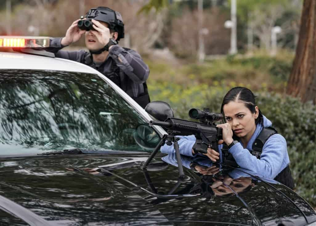 """SWAT Season 4 Episode 16 """"Lockdown"""" – When four escaped prisoners take control of a courthouse with Hondo and Deacon inside but unarmed, the two race to save the lives of innocent civilians while trying to avoid detection themselves. Also, Street visits his mother, Karen (Sherilynn Fenn), in the hospital and faces a pivotal decision, on S.W.A.T., Wednesday, May 12 (10:00-11:00 PM, ET/PT), on the CBS Television Network. Pictured (L-R): Alex Russell as Jim Street and Lina Esco as Christina """"Chris"""" Alonso. Photo: Sonja Flemming/CBS ©2021 CBS Broadcasting, Inc. All Rights Reserved."""