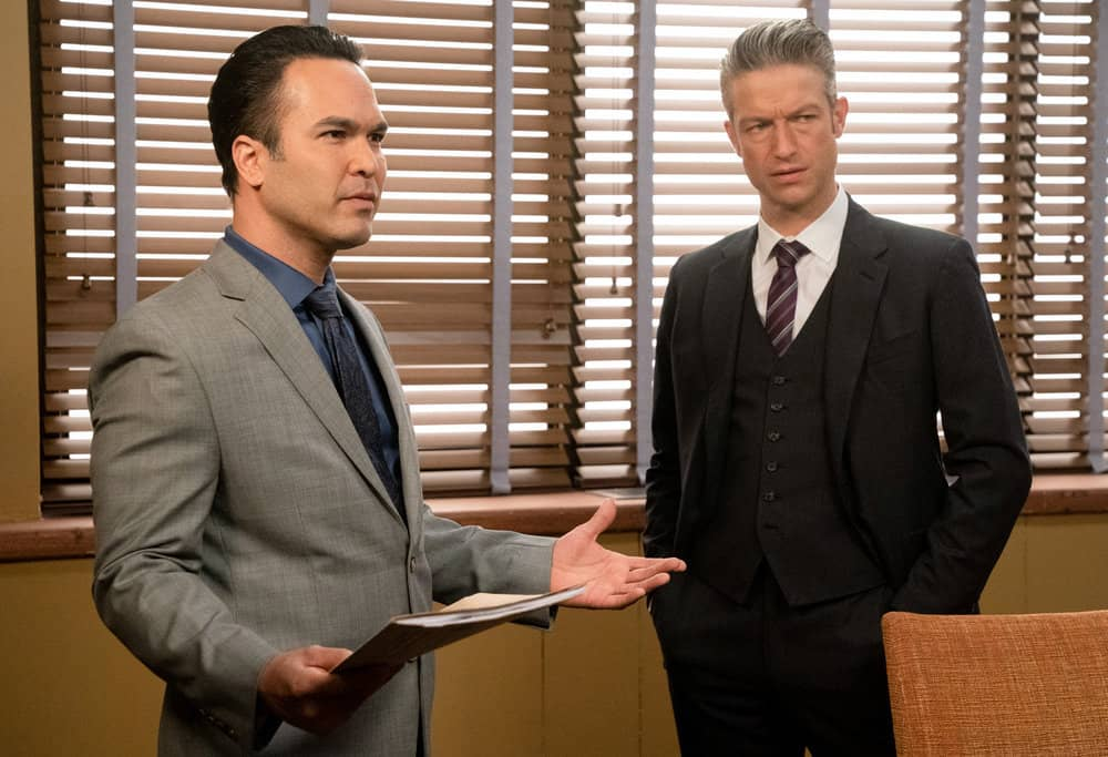 """LAW AND ORDER SVU Season 22 Episode 13 -- """"Trick-Rolled at the Moulin"""" Episode 22013 -- Pictured: (l-r) Adrian Alvarado as Detective Ray Fernandez, Peter Scanavino as Assistant District Attorney Sonny Carisi -- (Photo by: Virginia Sherwood/NBC)"""