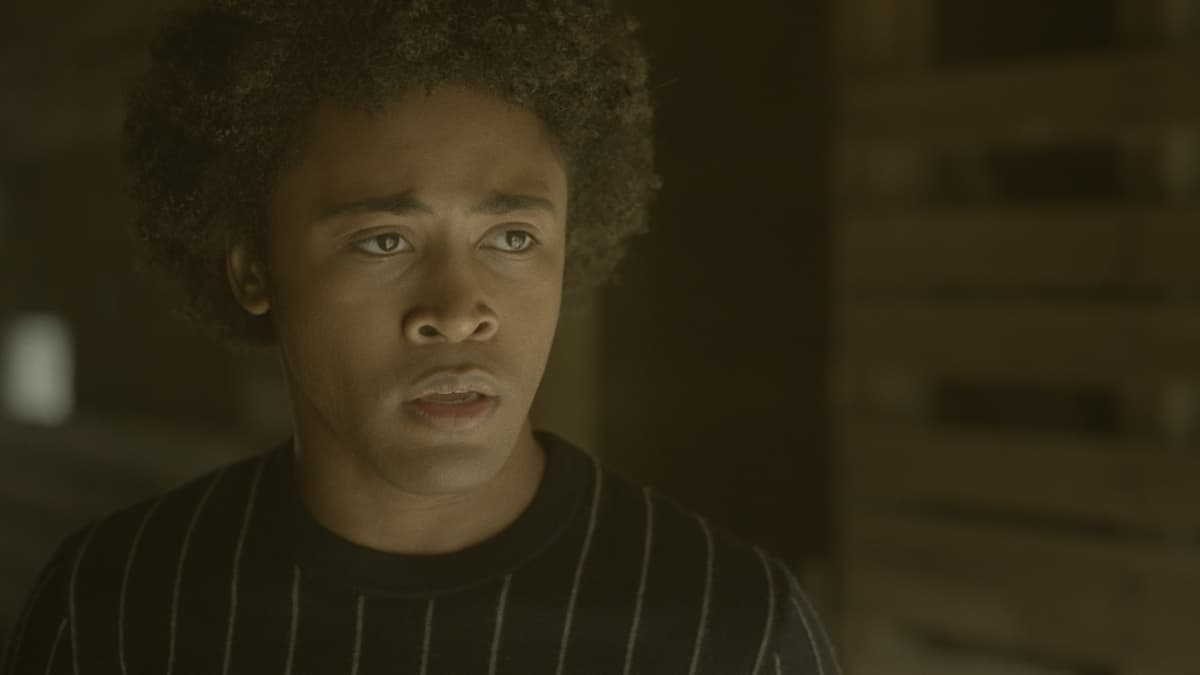 """LEGACIES Season 3 Episode 12 -- """"I Was Made to Love You"""" -- Image Number: LGC312fg_0013r -- Pictured: Quincy Fouse as Milton """"MG"""" Greasley -- Photo: The CW -- © 2021 The CW Network, LLC. All Rights Reserved."""